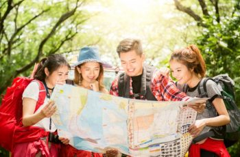 Hikers looking at the map - GPS Location Coordinates